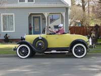 Model A car in front of house
