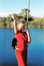 Young girl holding fish & pole